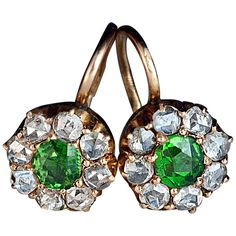 Antique Russian Demantoid Rose Cut Diamond Earrings. made in Kiev between 1908 and 1917  The 14K gold cluster earrings are centered with vivid green Russian demantoids (approximately 0.61 ct total weight) surrounded by old rose cut diamonds.  Marked with 56 zolotnik gold standard, maker's initials and later Soviet control mark.