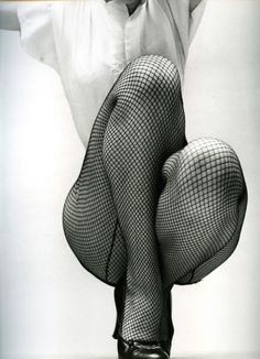 Fishnets and heels. Works every time.    theniftyfifties:    The Dancer by Fernand Fonssagrives, 1952.