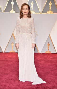 Isabelle Huppert in Armani Privé and Repossi jewelry