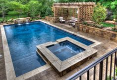 SwimThings designed and installed a heated gunite pool with a marbled midnight blue finish. Frost-proof ceramic tiles were used at the waterline while a natural travertine tile border frames the elegant pool and spa. Swimming Pool Landscaping, Small Backyard Pools, Backyard Pool Designs, Swimming Pool Designs, Landscaping Ideas, Pool Spa, My Pool, Living Pool, Geometric Pool