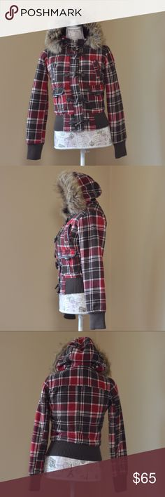 "Plaid Wool Blend Toggle Coat w/Furry Hood Description: Zipper closure with toggle flap, lots of pockets. Furry hood. Removable Fur for washing. 45% wool, 47% polyester & 4% nylon.  Bust: 17 1/2"" flat across Shoulder: 14 1/2"" flat across Waist: 13 1/2"" flat across Length: 20"" from shoulder to hem Sleeve: 24 1/2"" from shoulder to wrist Defects: Lining not super soft anymore but still very warm. 2 buttons inside hood replaced. Condition: Excellent Custom bundles for a special price Model Stats…"