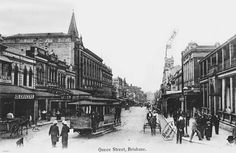 Corner of Queen and George Street, Brisbane, Queensland, ca. 1907 - Part of postcard series showing the corner of Queen and George Street, Brisbane, looking north, ca. 1907. A Paddington - Bulimba Ferry tram is shown in the foreground, and a small horsedrawn buggy. A poilceman is standing at the corner as well as some men and boys wearing boater hats. Buildings near the intersection are clearly depicted.