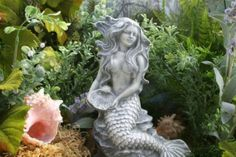 I love this piece ~ Mermaid Statues  Outdoor Sculpture Garden Mermaid by PhenomeGNOME.etsy.com