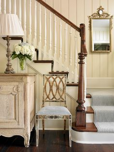 Benjamin Moore OC-8. Foyer wall paint color is Benjamin Moore OC-8 Elephant Tusk. Stairway balusters, banisters, stringers and risers are painted in Benjamin Moore OC-8 as well. #BenjaminMooreOC8