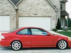 2000 Honda Civic - red.  Mine was silver. Ma ny great memories are associated with the last car my dad helped me choose.  I chose the silver, but next time, it will be red.  Great car.  6 years, my record for keeping a car.