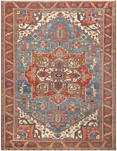 Click here to learn more about this lovely antique Persian Heriz room sized rug, which is currently available for sale through Nazmiyal.