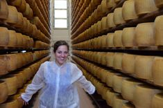 """Kate Running Through a Parmigiano Reggiano Factory - """"Magical Moments in Emilia-Romagna"""" by @Kate McCulley"""