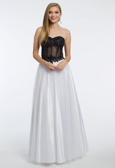 Get decked out in this luxe prom dress! With its sweetheart neckline, corset illusion bodice, mesh ball gown skirt, and lace up back, this ball gown dress is ready for a gala. #CLVprom17 #camillelavie
