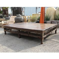 Antique Indian Thaket coffee table.  Teak wood construction with spindle work and carved detail around all sides.  Antique one of a kind large coffee table - circa 1920.