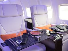 How a Flight on the Four Seasons Private Jet Compares to a Commercial Plane