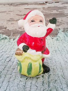 Check out this item in my Etsy shop https://www.etsy.com/listing/115425174/kitsch-ceramic-santa-claus-figurine