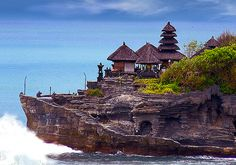 Tanah Lot, Bali.  Pura Tanah Lot is a temple located on a rock formation jutting from the island of Bali. An isolated temple only accessible via a narrow spit of rock would be a nice place for a pilgrimage, but the legends about Tanah Lot make it even more interesting. It was supposedly designated a holy site by a 15th century Hindu priest, and is said to be guarded by a giant snake created from the priest's scarf.