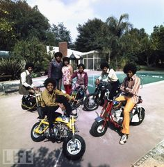 Sitting atop motorbikes, the Jackson Five -- Michael, Jackie, Marlon, Tito, and Jermaine -- join their father Joe and mother Katherine in their backyard in Encino, California.