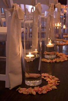 A small circle of petals around a tall pillar is a reasonably low-cost, high-elegance way to decorate your aisle.