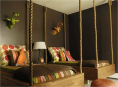 WOW!! Another amazing bunk-bed alternative, hanging beds by rope! So masculine with the brown and then the Moroccan pop of colour with the leather ottoman and a not to sea house antler feature! Not sure if I like this colour scheme but love the concept!!