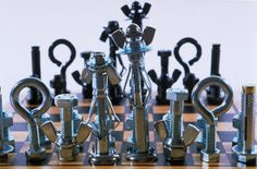 Loose parts play with nuts and bolts. This website provides instructions on how to create chess pieces. Nuts and Bolts play good for fine motor play.