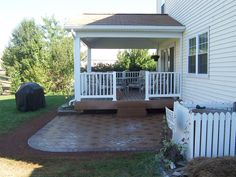 paver patio off screened porch via http://www.canalelandscaping.com