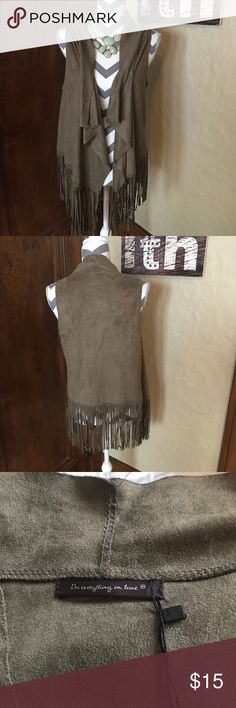 NWT Fringe Vest One Size All the fringe! Faux suede feel to it. Fringe is in good condition. No size according to the label. From Glik, a pacsun/resort type store. Jackets & Coats Vests