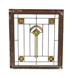 "original early 1920's prairie school style interior residential leaded art glass window featuring a centrally located segmented diamond with gold ""flash"" glass"