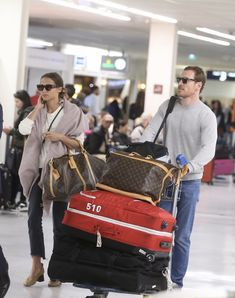 Michael Fassbender & Alicia Vikander Spotted at Airport Ahead of Possible Wedding!: Photo Michael Fassbender is all smiles as he and Alicia Vikander make their way through the Charles de Gaulle Airport on Tuesday afternoon (October in Roissy, France. Alicia Vikander Style, Michael Fassbender And Alicia Vikander, Super Secret, Celebs, Celebrities, Celebrity Couples, Persona, Brave, Messenger Bag