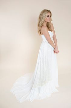 Strapless Wedding Dress with Lace | Andy Darling | This free-spirited strapless wedding gown features a ruched wrapped bodice leading your eye to the natural waist that is finished with a silk ribbon. Layers of chiffon, embroidery ribbon, and cotton lace finishes the layered look at the skirt. Visit our website to learn more about this strapless wedding dress with lace! #wedding #weddingdress #weddinginspo #bride #bridal #bridalinspo #lace #strapless Strapless Lace Wedding Dress, Boho Wedding Dress, Wedding Gowns, Lace Silk, Silk Ribbon, Cotton Lace, Yes To The Dress, Boho Bride, Bridal Boutique