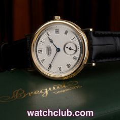 Breguet Classique Ultra-Slim Automatic - Yellow Gold REF: 5920BA | Year Dec 2004 The classic Breguet. With a silver hand guilloched dial, fluted case sides and the unmistakable Breguet hands, this discreet gentlemans dress watch is in pristine condition. Remarkable for such a slim watch is the automatic calibre 516/1 movement with 96 hour power reserve - for sale at Watch Club, 28 Old Bond Street, Mayfair, London
