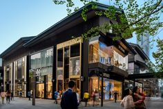 Metropolis striving to become a hub for consumer services Shopping Mall Architecture, Retail Architecture, Chinese Architecture, Commercial Architecture, Residential Architecture, Architecture Design, School Architecture, Shopping Street, Street Mall