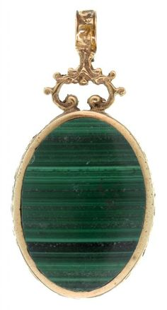 AN OVAL DOUBLE SIDED PENDANT, SET WITH MALACHITE AND BLUE JOHN  Sold @ Mellors & Kirk