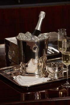 Vintage hotel serving pieces inspired the elegantly simple shape of the Durban Champagne Bucket from Ralph Lauren Home.