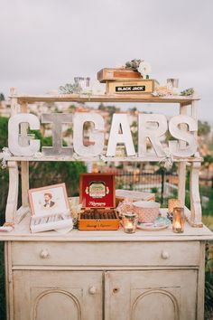 Ruby Cabinet and Grand Vintage Cigar Boxes at Casa Romantica with Going Lovely, Kelly Stonelake Photography, and Found Vintage Rentals.  I love this idea for not necessarily cigars but for other stations you could have at a wedding, candy, libations, etc etc..