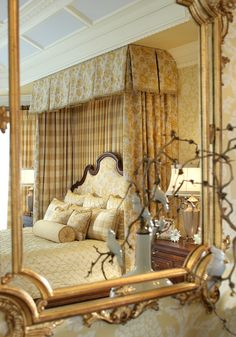 Gorgeous master bedroom....this isn't particularly masculine,but with the right fabric,this would look great in a man's master bedroom.