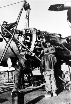 Replacing the engine on a B-17 Flying Fortress of the 398th Bombardment Group.