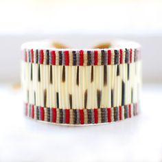 This stunning porcupine quill bracelet is by Inuit artist Caroline Blechert. We love it! >> http://shop.beyondbuckskin.com