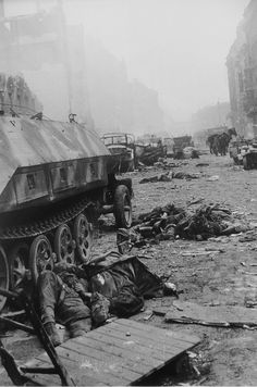 German KIAs and koncked out armor of Waffen SS Division Nordland in a Berlin street following Nordland's desperate, but failed, attempt to break out of the Russian encirclement, April 1945..
