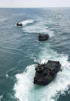 SULU SEA; A group of amphibious assault vehicles (AAV) wait to embark the well deck of the amphibious dock landing ship USS Germantown (LSD 42) during an amphibious exercise held in support of Cooperation Afloat Readiness and Training (CARAT) Malaysia.