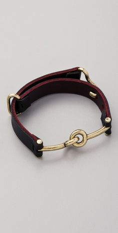 I love the industrial look of this bracelet, and the combination of leather and metal.