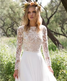 modest wedding dress with long sleeve and a flowy skirt from alta moda…