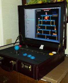 Tired of hosting his Arcade Club's gaming sessions at home, Travis Reynolds made the Briefcade. Arcade Club, Assemble!... Somewhere else. Travis originally wanted to make a foldable tabletop arcade machine, but he eventually scrapped it in favor of the Briefcade.