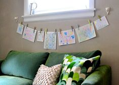 a cute way to display art or hang up cards, also can cover clothespins with scrapbooking paper to add some color