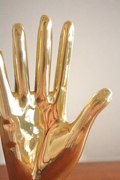 Modern midcentury brass hand - might be a prezzie for @Tatiana Bowe Packer