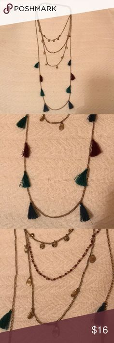 Boho Multi Layered Necklace NWOT. Boho multi layered necklace. See pics for layer details: navy, hunter green, burgundy tassels; gold teardrop charms; burgundy beading. Never worn. Xhilaration Jewelry Necklaces