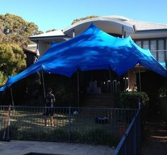 Blue Stretch Tent Marquee attached to the house
