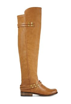 Tall and mighty, Ensley by JustFab is an over-the-knee boot with slim studded straps at the ankle and calf.