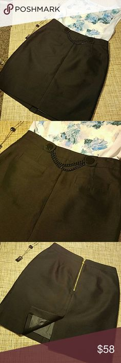 """Kate Spade skirt Never worn, I bought it and never wore it. Absolutely gorgeous skirt with chain like at the front, faux pockets, fully lined with gold zipper at the back and slit at the bottom. Fabric blend of silk, rayon and cotton. Waist 14.5"""", lenght 20"""", hips 19.5"""" kate spade Skirts"""