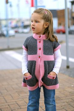 """Pepper is a very playful and modern girl's cardigan featuring cute pockets and simple lines. It is a part of the """"Spice Girls"""" series of cardigans designed for every day wear, and each one has a little unique spice of their own."""