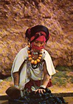 Berber woman doing the washing. Atlas Mountains Morocco