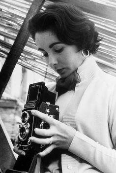 """lizandmarilyn: """" Elizabeth Taylor with a Rolleiflex camera, """""""