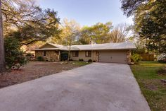 Desirable Neighborhood and Location!!! This immaculate ranch style, brick home invites 4 Bedrooms. 2.5 Baths Rocky Bayou Estates almost 1/2 acre lot