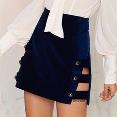NASTY GAL Day Tripper Navy Blue Velvet Mini Skirt The Day Tripper Skirt is made in navy velvet and features a strappy side-slit design, gunmetal dome buttons at side and enclosed zipper at back. Fully lined, brand new with tags. Nasty Gal Skirts Mini