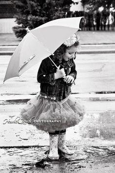 Playing in the rain by Susan John